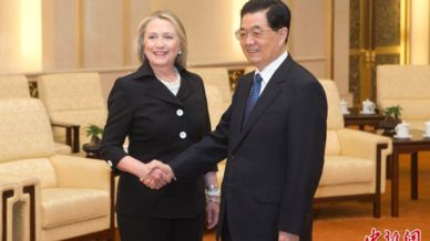 Hillary Clinton shaking hands with Chinese minister.